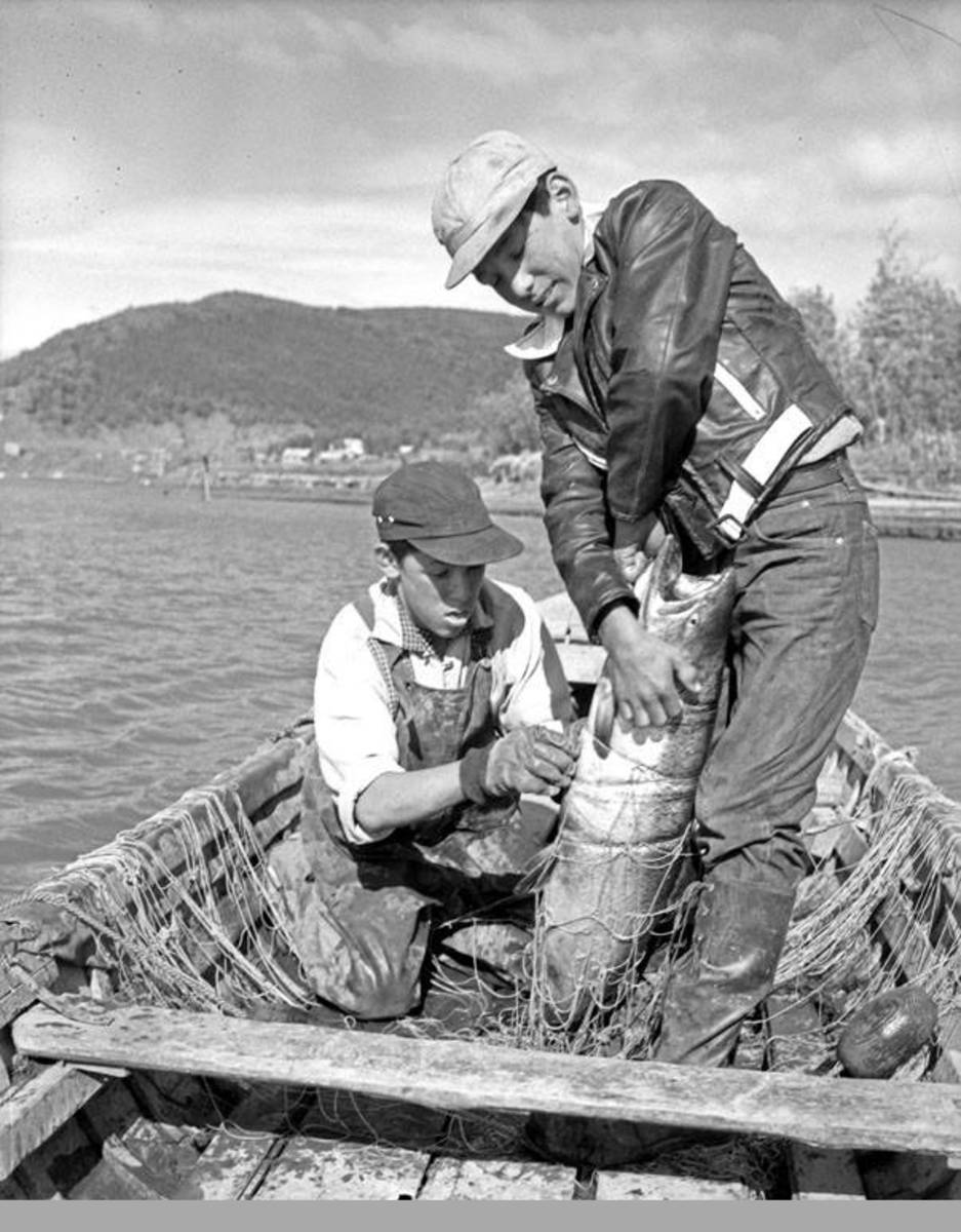 Alaska Native subsistence fishing in the village of Piamute. (Photo courtesy of the Anchorage Museum at Rasmuson Center).