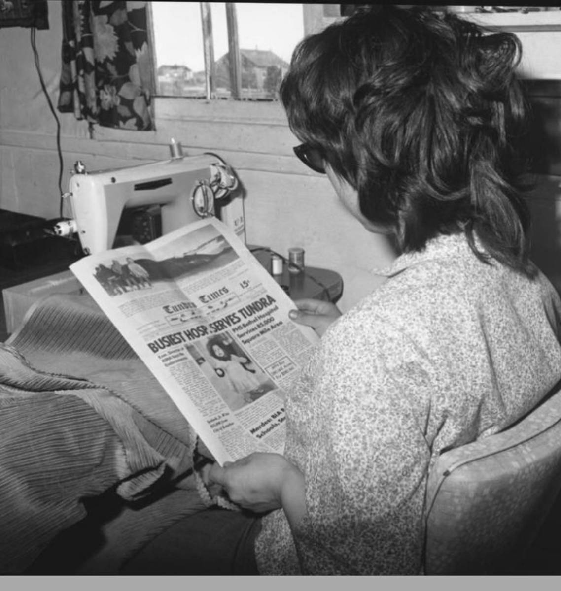 Dorcas Rock reading the Tundra Times. (Photo courtesy of the Anchorage Museum at Rasmuson Center).