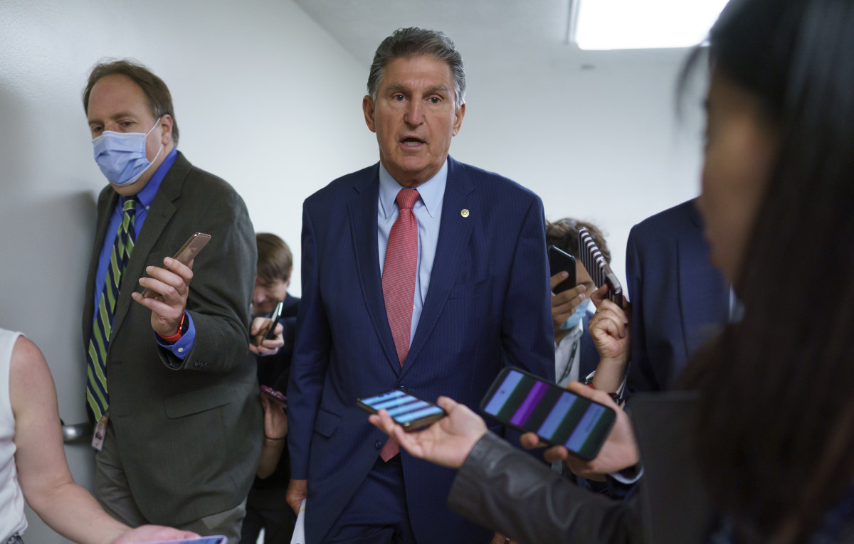 Sen. Joe Manchin, D-W.Va., is surrounded by reporters as senators rush to the chamber for votes ahead of the approaching Memorial Day recess, at the Capitol in Washington, Wednesday, May 26, 2021. Lawmakers still face standoffs on an infrastructure bill, police reform, voting rights, and a bipartisan commission to investigate the Jan. 6 attack on the Capitol. (AP Photo/J. Scott Applewhite)