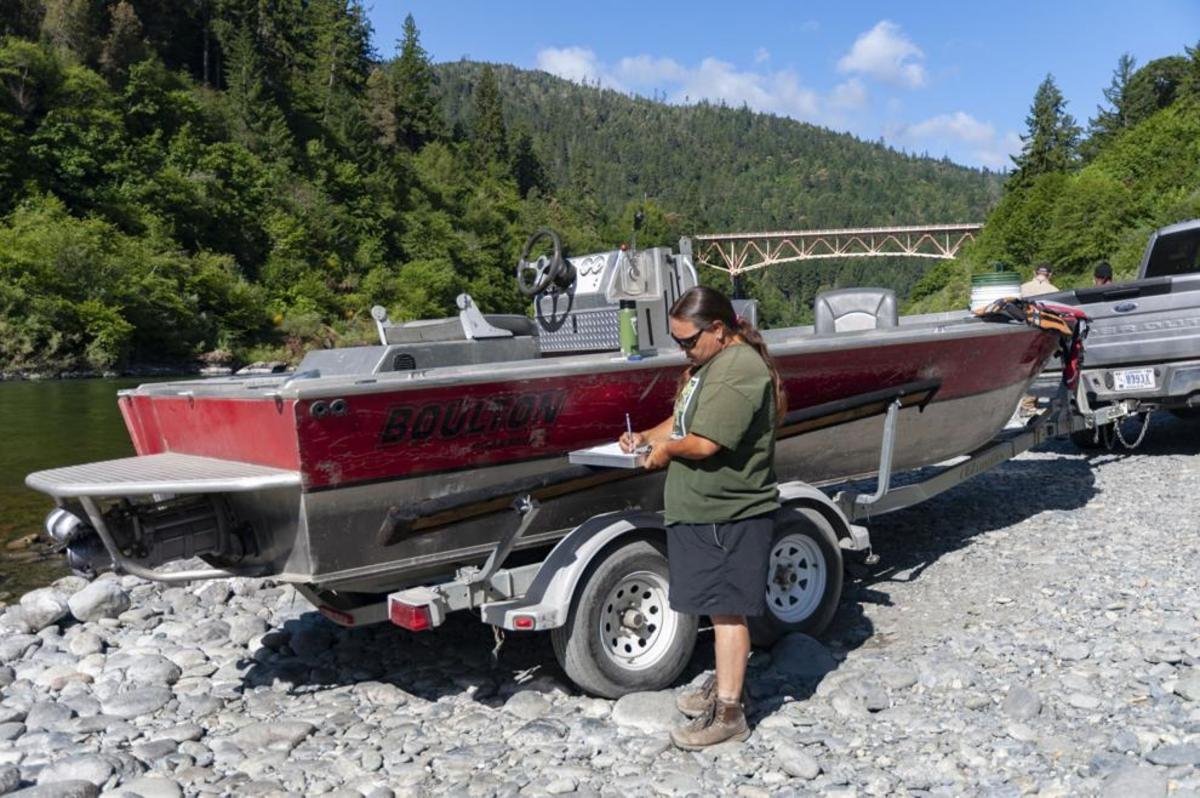 Jamie Holt, fisheries technician for the Yurok Tribe and a Yurok citizen, prepares to take a boat out to check the screw trap at Weitchpec. (Photo by Alex Schwartz/Herald and News)