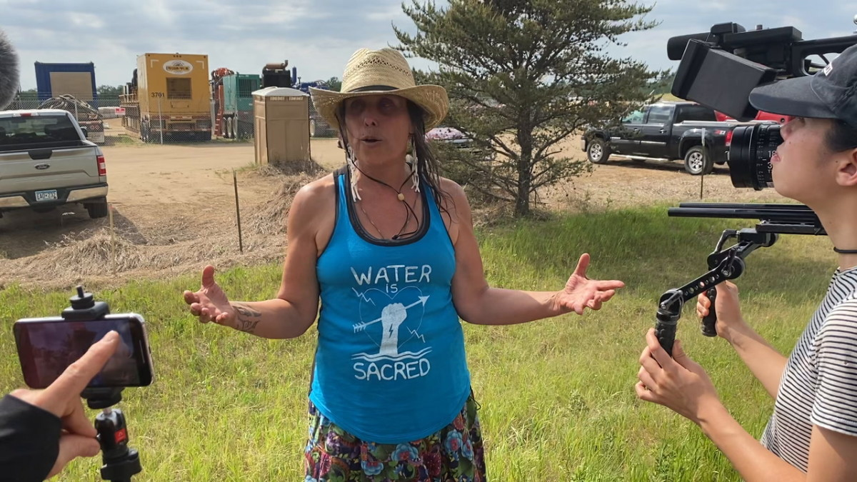 Winona LaDuke, executive director of Honor the Earth, speaks about a protest march on June 7, 2021 to stop construction of Enbridge's Line 3 pipeline project in northern Minnesota. (Photo by Mary Annette Pember, Indian Country Today)