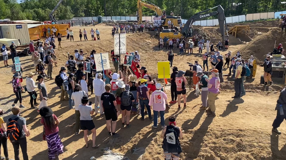 Water protectors take over the Enbridge Line 3 pumping station in Hubbard County near Park Rapids, MN to stop construction of on June 7, 2021. Some people locked themselves down to pipeline construction equipment. (Photo by Mary Annette Pember/Indian Country Today)