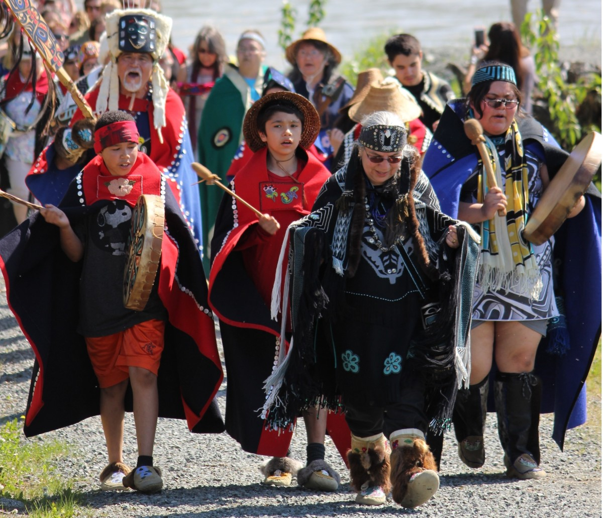 """Tlingit Community members in Klukwan, Alaska, march in 2015 in honor of Lani Hotch, a weaver and citizen of the Chilkat Indian Village in Haines, Alaska. Hotch was named a First Peoples Fund Community Spirit Award honoree. """"A truth that's unknown to most Americans is that art and culture are and always have been a central force in tribal communities and economies,"""" said First Peoples Fund President Lori Pourier. (Photo courtesy of First Peoples Fund)"""