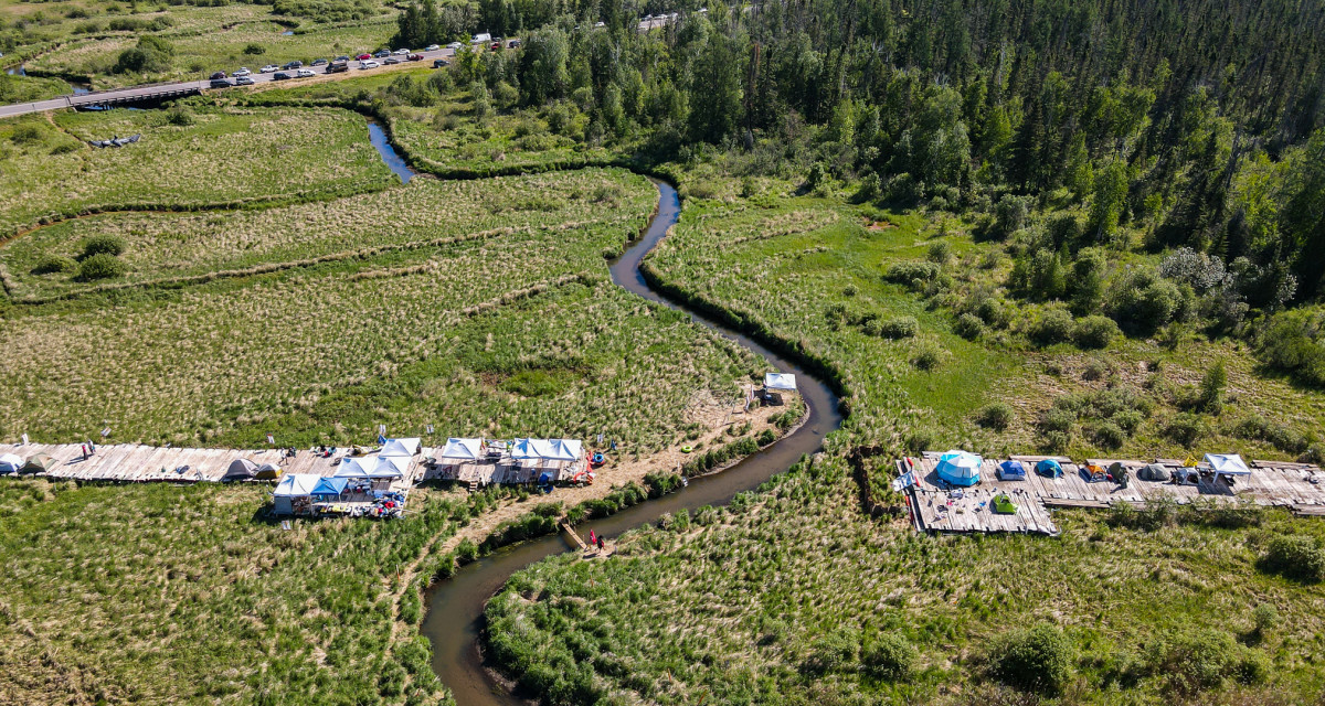 Aerial view of the Fire Light camp along the Mississippi River at an Enbridge Line 3 construction site near Solway, Minnesota. The camp went up on June 7, 2021, and the protest peaceably ended on June 14, 2021, unlike protests at other sites that led to mass arrests. (Photo courtesy Ron Turney, Line 3 Media Coalition)