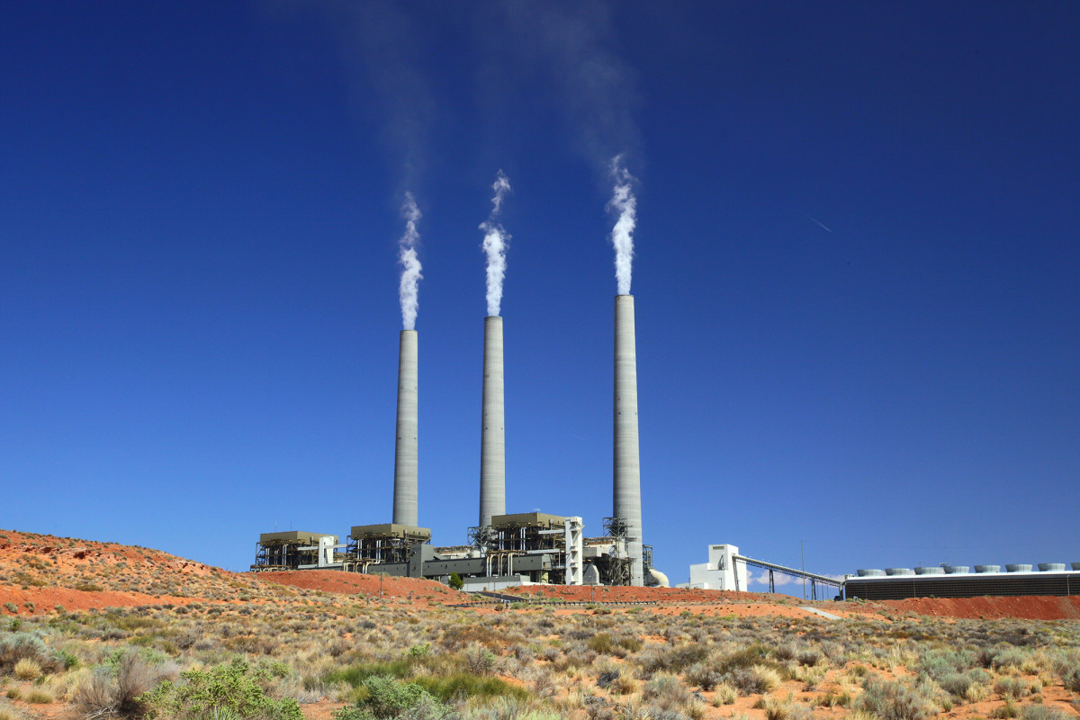 The Navajo Generating Station, once the largest coal-burning plant in the West, closed in 2019 when coal was no longer economically feasible fuel. It was the only client of the nearby Kayenta mine, which also closed. (Photo by Bill Morrow, Creative Commons)