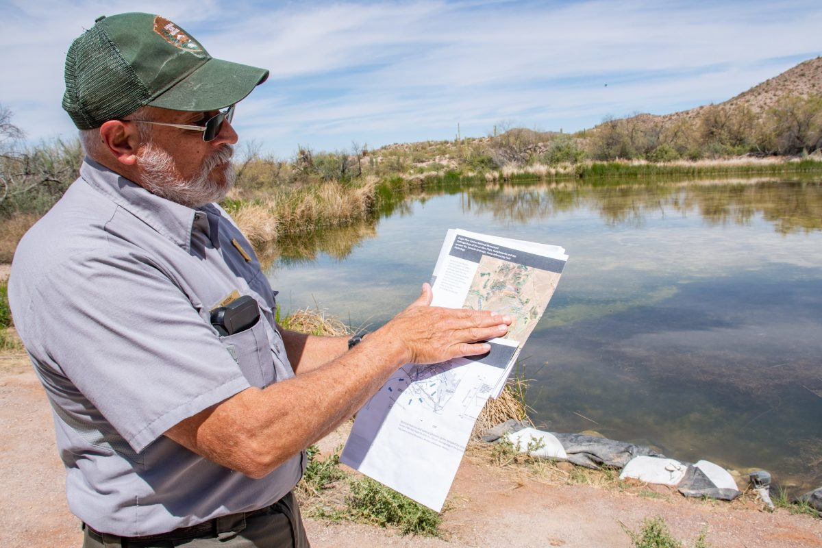 Rijk Morawe, the chief of natural and cultural resources management at Organ Pipe Cactus National Monument, displays a USGS study of the hydrogeology of the Quitobaquito Springs and La Abra Plain area on March 28, 2021. The wells tapped for border wall construction are outside the spring's recharge area, he says, and are not the reason flow rates are down. (Photo by Isaac Stone Simonelli/Cronkite Borderlands Project)