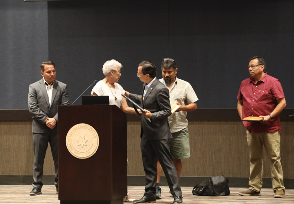 Pictured: Cherokee Nation Principal Chief Chuck Hoskin Jr. accepts a memorial plaque from the Cherokee Speakers Council in North Carolina in honor of Cherokee speakers lost over the past year. Left to right: Eastern Band of Cherokee Indians Principal Chief Richard Sneed, Cherokee language speaker Myrtle Driver, Cherokee Nation Principal Chief Chuck Hoskin Jr., Cherokee language speakers Bo Lossiah and Roger Smoker.
