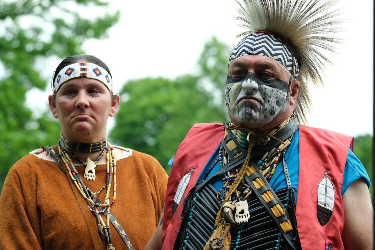 Shelly Wolf Mother and Tommy Blue Dancer listen briefly to Chief Glenna Wallace's presentation at the Serpent Mound park in Peebles, Ohio before returning to the Soaring Eagle grounds next door. (Photo by Mary Annette Pember)