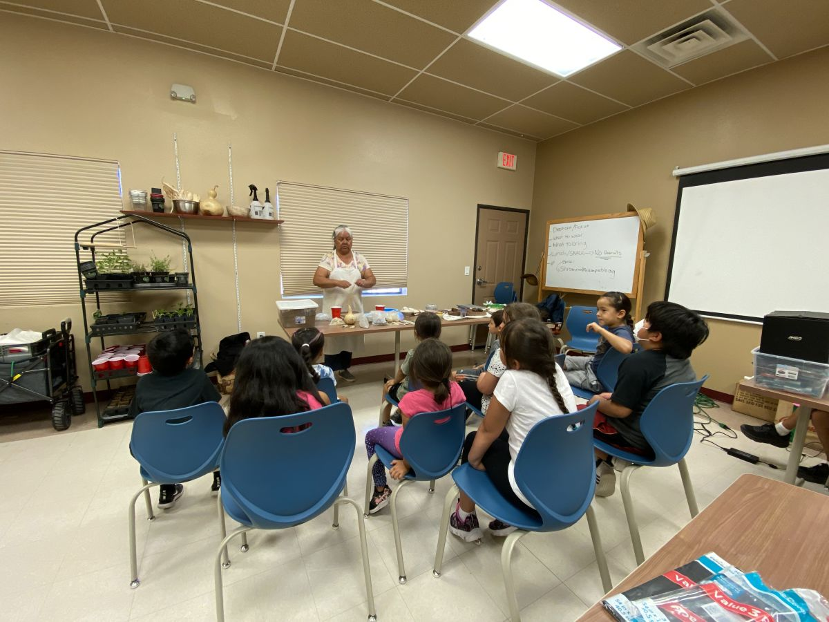 """Acoma Pueblo potter Claudia Mitchell speaks to campers at the """"traditional teachings"""" summer camp in Albuquerque, NM. (Photo by Aliyah Chavez, ICT)"""