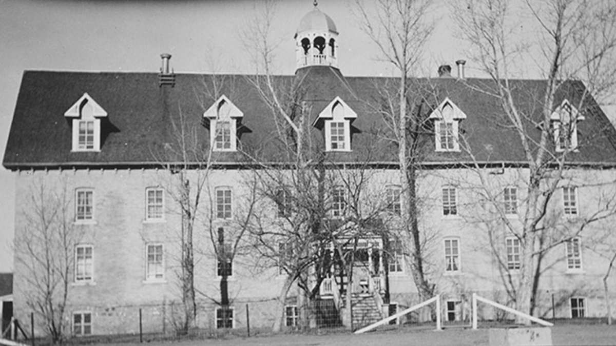 This historical image shows the Marieval (Cowessess) Indian Residential School in Saskatchewan, Canada. More than 700 remains were discovered at the site in unmarked graves in late June, 2021. The school was run for years by the Catholic Church. (Photo courtesy of St. Boniface Historical Society Archives via APTN National News)