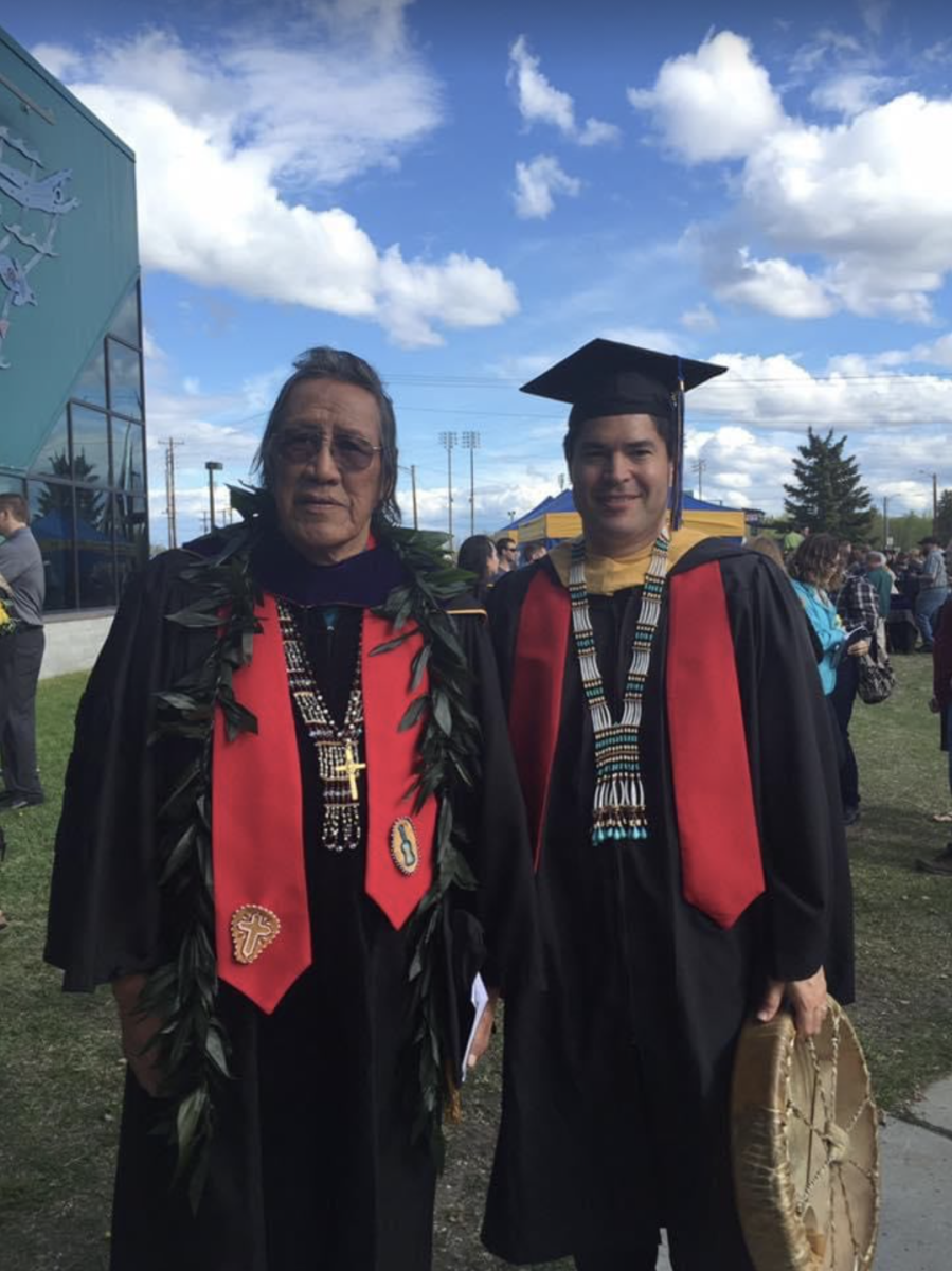 At left: Dr. Trimble Gilbert, Gilbert, who was born in 1935, is the traditional chief of the Neets'aii Gwich'in people in his birthplace of Arctic Village. He is shown here on May 8, 2016, the day he received an honorary doctorate degree from the University of Alaska Fairbanks. He lives a traditional subsistence lifestyle, and is a mentor and teacher to then-University of Alaska Fairbanks vice chancellor for rural, community and Native education Evon Peter (at right). (Photo courtesy of Evon Peter).