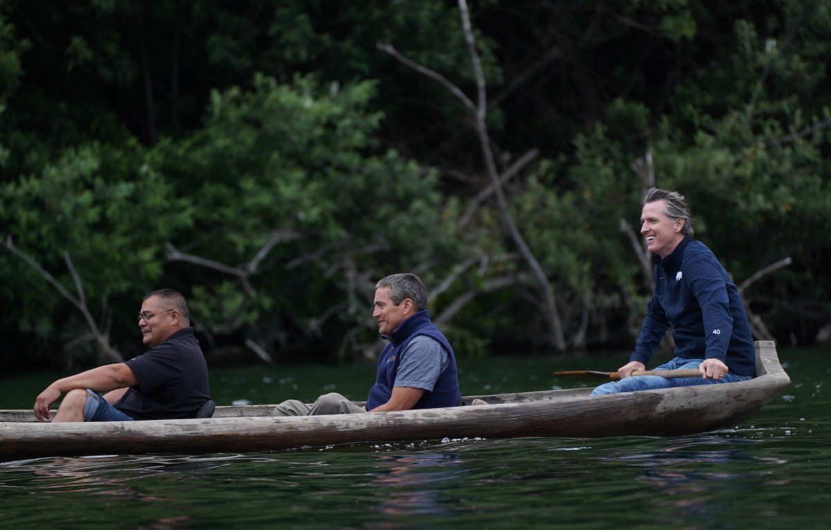 Pictured: Yurok Chairman Joseph L. James, California Natural Resources Secretary Wade Crowfoot and Governor Gavin Newsom travel in a traditional redwood canoe down the Klamath River on the Yurok Reservation.