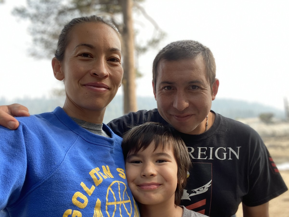 """Author Tommy Orange, whose first novel """"There There"""" won universal acclaim, is shown here in this 2021 photo with his wife, Kateri, and son, Felix. He credits the birth of his son in 2010 with pushing him to write the novel. (Photo courtesy of Kateri Orange)"""