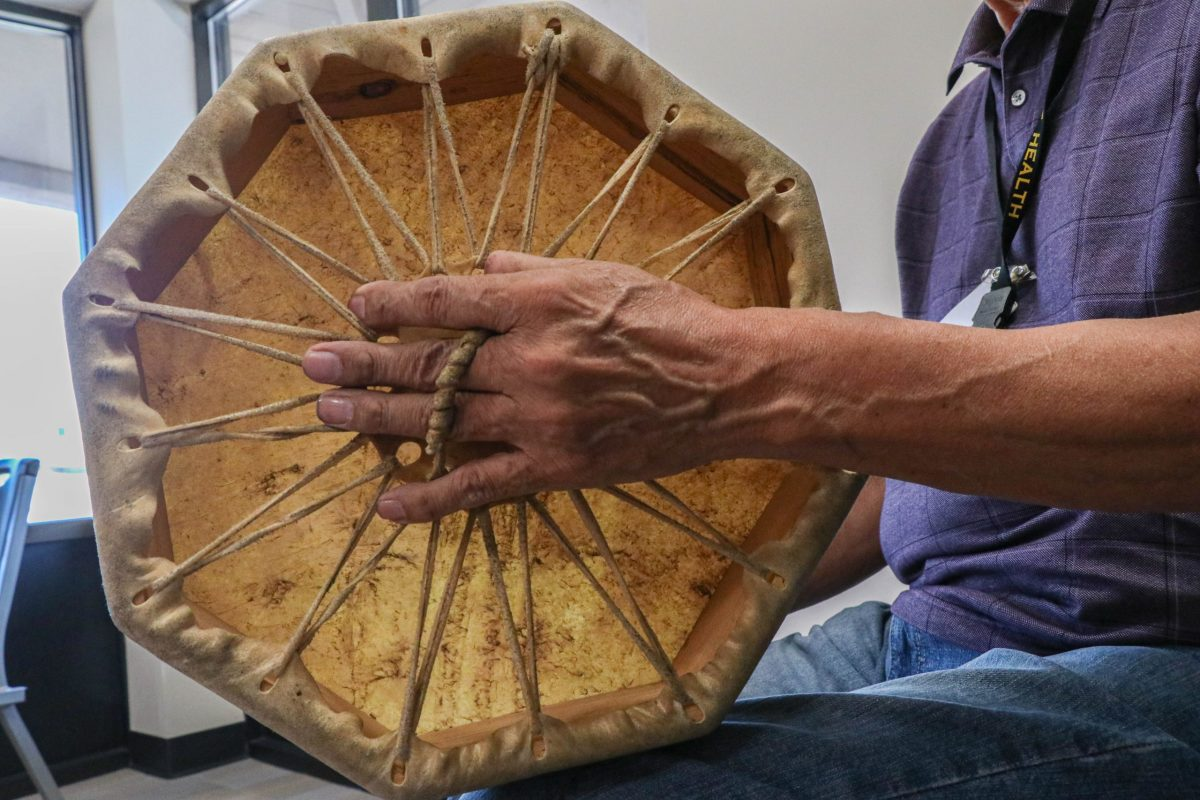 Roy Johnston, a traditional specialist at Native Health in Mesa and a member of the Choctaw Nation, plays a drum and sings when he hosts talking circles. (Photo by Gianluca D'Elia/Cronkite News)
