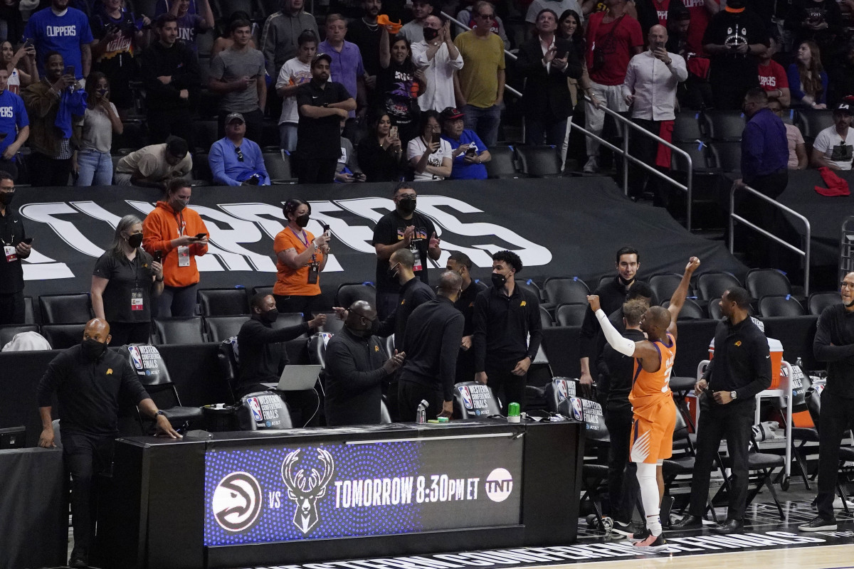Phoenix Suns guard Chris Paul celebrates toward fans as time runs out in Game 6 of the NBA basketball Western Conference Finals against the Los Angeles Clippers Wednesday, June 30, 2021, in Los Angeles. The Suns won the game 130-103 to take the series 4-2. (AP Photo/Mark J. Terrill)
