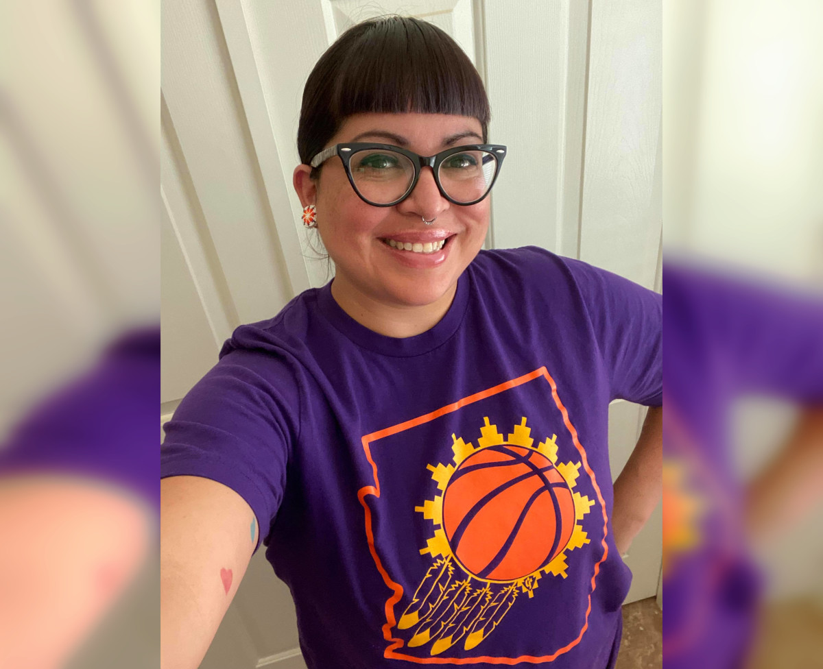 Recent photo of Jacelle with the Can't Fail Designs suns t-shirt. (Photo courtesy of Jacelle Ramon-Sauberan)