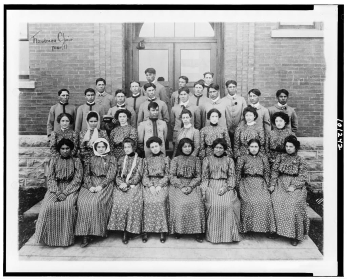 Male and female choir members pose at Flandreau Indian School in South Dakota, circa 1909 to 1932. The off-reservation school remains in operation. (Photo courtesy of the Library of Congress)
