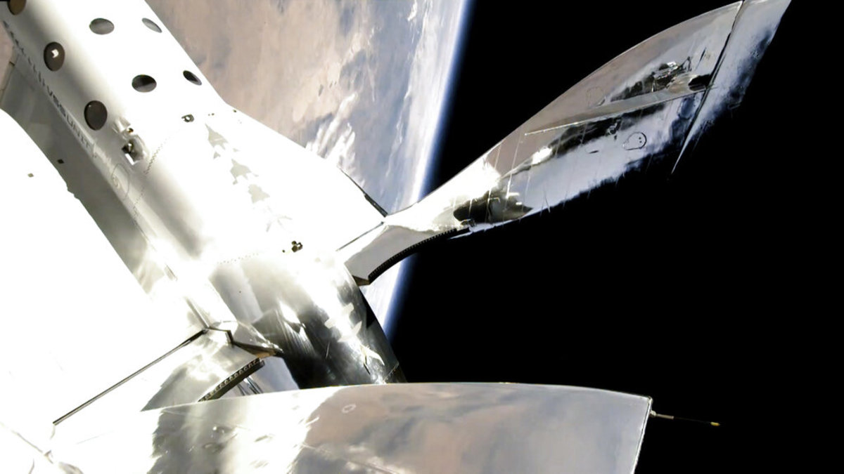 In this photo provided by Virgin Galactic, the VSS Unity reaches a speed of Mach 3, and a space altitude of 53.5 miles above the Earth on Sunday, July 11, 2021. Entrepreneur Richard Branson and five crewmates from his Virgin Galactic space-tourism company reached an altitude of about 53 miles (88 kilometers) over the New Mexico desert, enough to experience three to four minutes of weightlessness and see the curvature of the Earth. (Virgin Galactic via AP)