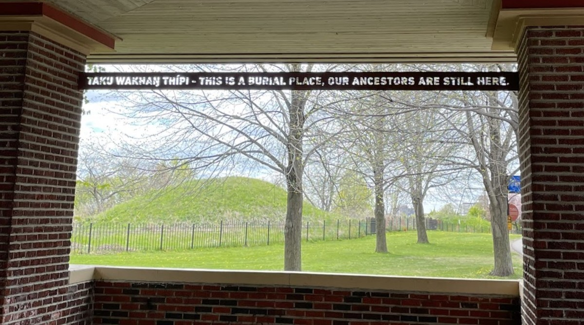 A metal sign installed in a structure in the park that can be seen when looking toward the mounds. (Photo courtesy of Sam Odegard)