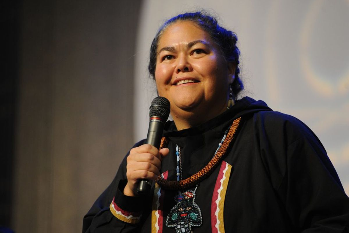La quen náay Liz Medicine Crow, Tlingit and Haida, speaks during the Elders and Youth Conference at the Dena'ina Center in Anchorage. Medicine Crow is a tribal citizen and Sealaska shareholder, and was raised in the village Kake. She felt her connection to the land shaped her cultural identity. (Photo courtesy of Bill Roth, Anchorage Daily News archive)