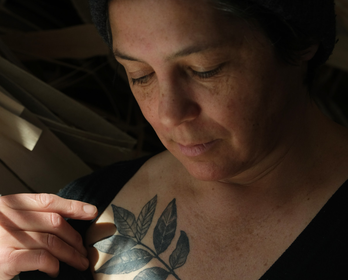 Basket artisan April Stone, a citizen of the Bad River Band of Ojibwe, shows her black ash leaf tattoo in March 2021. She makes baskets from the black ash tree on the the Bad River Reservation in Wisconsin. (Photo by Mary Annette Pember/Indian Country Today)