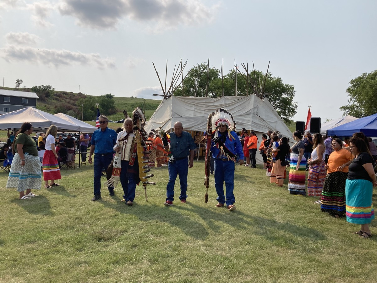 Tribal leaders led the procession out of the council teepee after praying for the remains of nine Sicangu children whose remains were returned from Carlisle Indian Industrial School more than 140 years after they were forcibly taken from their families. Shown here on July 16, 2021, are, from left, Rosebud Sioux Tribe President Rodney Bordeaux, Chief Duane Hollow Horn Bear, and spiritural leaders Richard Moves Camp and Keith Horse Looking Sr. (Photo by Vi Waln for Indian Country Today)