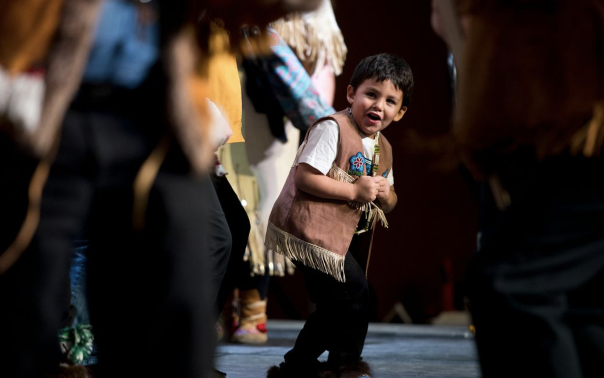Liam Baker, 3, dances with the Minto Dancers at the Alaska Federation of Natives.