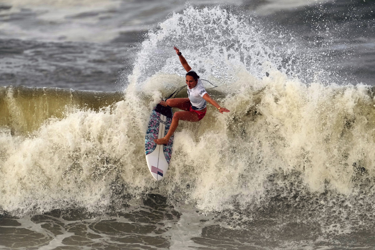Carissa Moore, of the United States, preforms on the wave during the gold medal heat in the women's surfing competition at the 2020 Summer Olympics, Tuesday, July 27, 2021, at Tsurigasaki beach in Ichinomiya, Japan. (AP Photo/Francisco Seco)