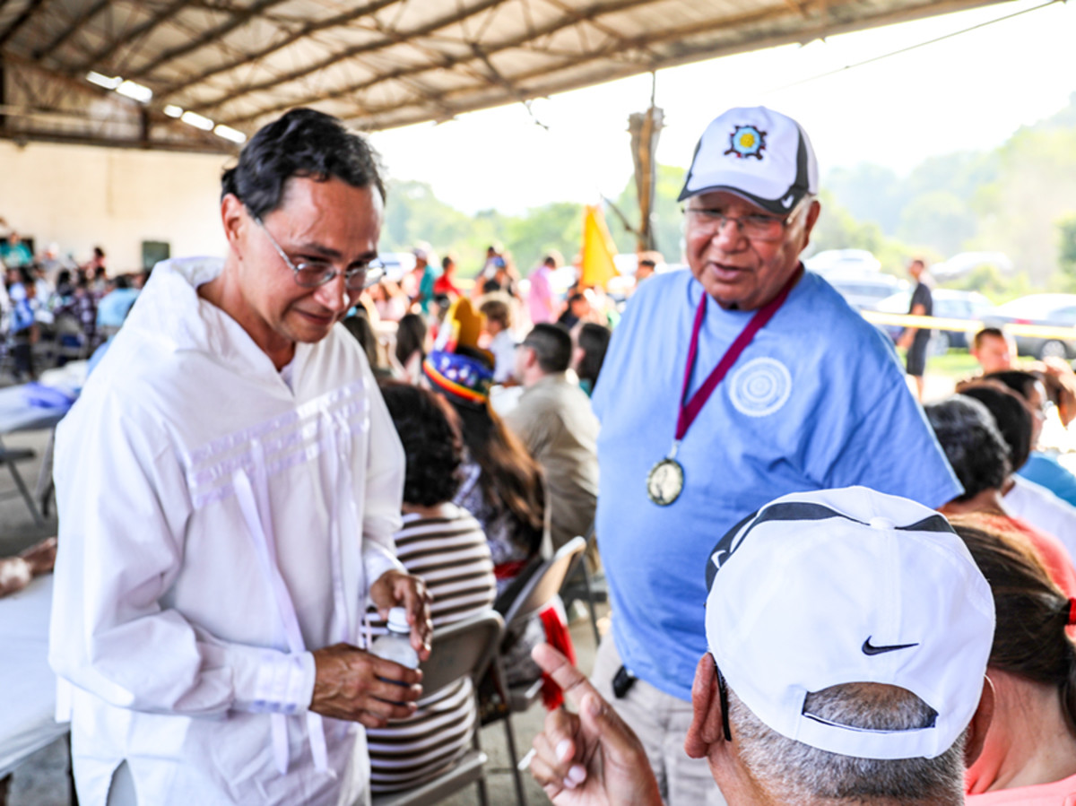 Pictured: Cherokee Nation Principal Chief Chuck Hoskin Jr. visits with fluent Cherokee speakers at the Kituwah celebration held in July at the Kituwah Mound near Cherokee, North Carolina.