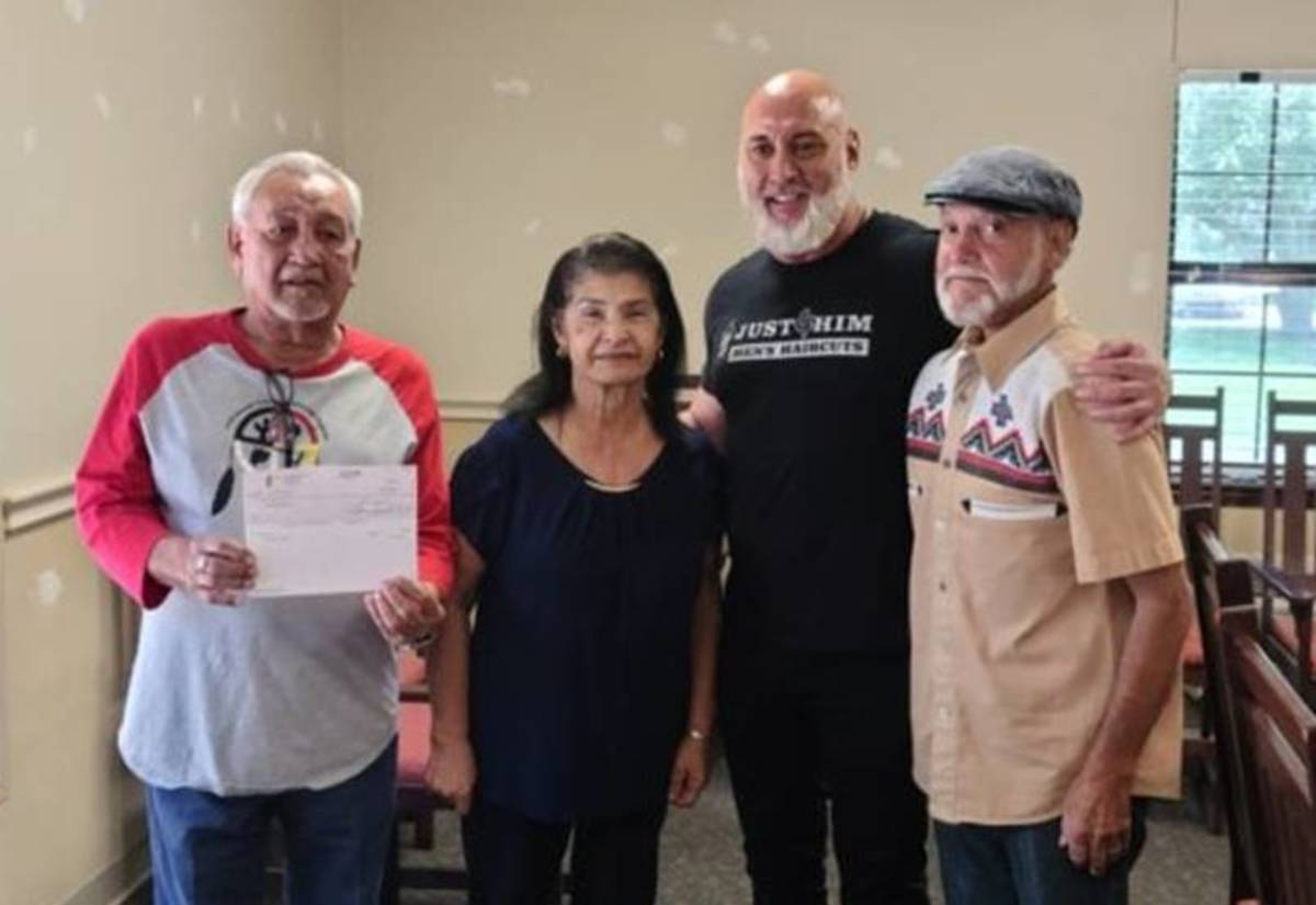 Pictured L-R: Lawrence Verdin, Marie Billiot, business owner Kevin Sevin, and Charlie Duthu.Mr. Sevin presented the United Houma Nation with a $5,000 check to support the tribe's Save Daigleville School efforts.