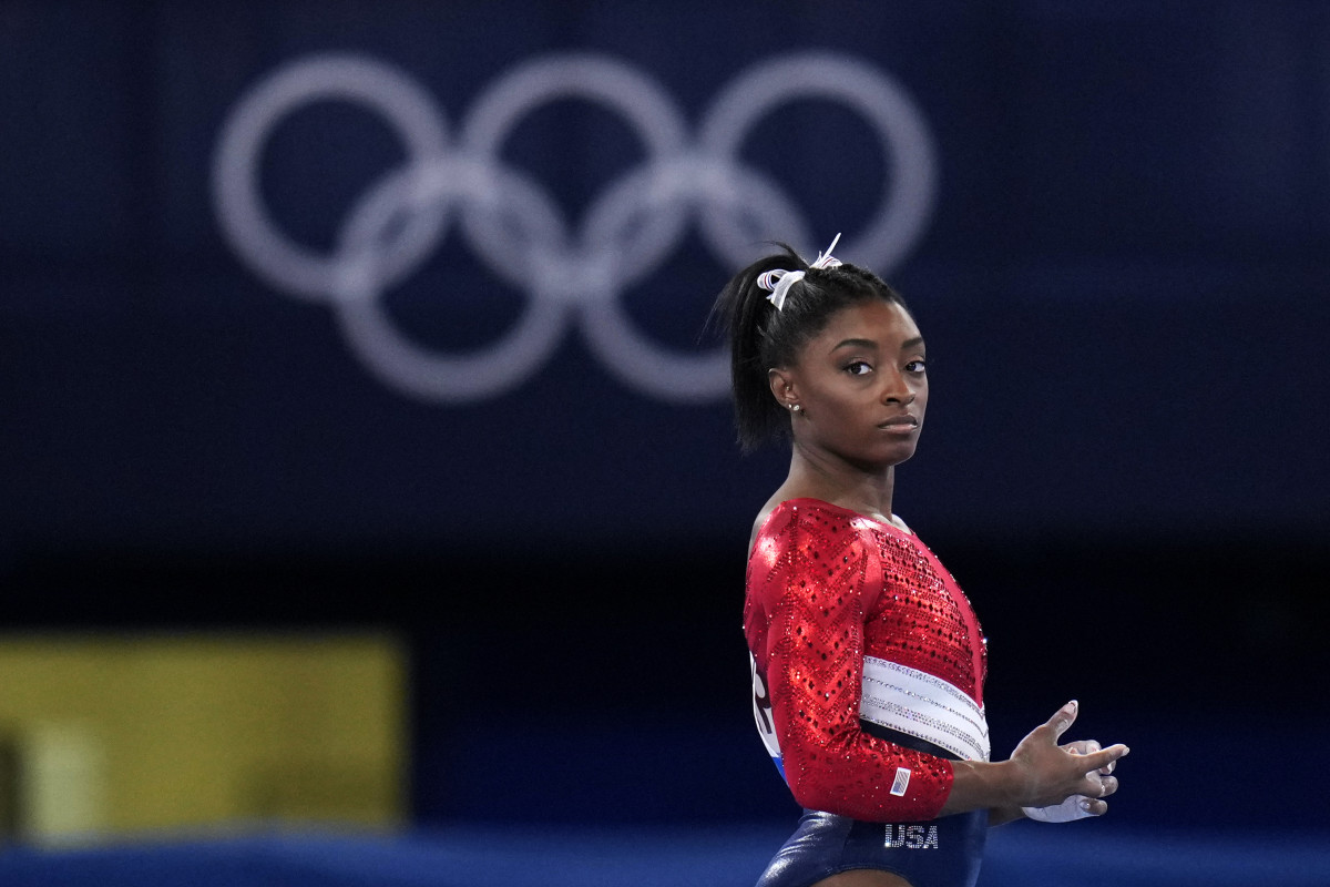 File-This July 27, 2021, file photo shows Simone Biles, of the United States, waiting to perform on the vault during the artistic gymnastics women's final at the 2020 Summer Olympics, Tuesday, July 27, 2021, in Tokyo. Biles' sponsors including Athleta and Visa are lauding her decision to put her mental health first and withdraw from the gymnastics team competition during the Olympics. It's the latest example of sponsors praising athletes who are increasingly open about mental health issues. (AP Photo/Gregory Bull, File)