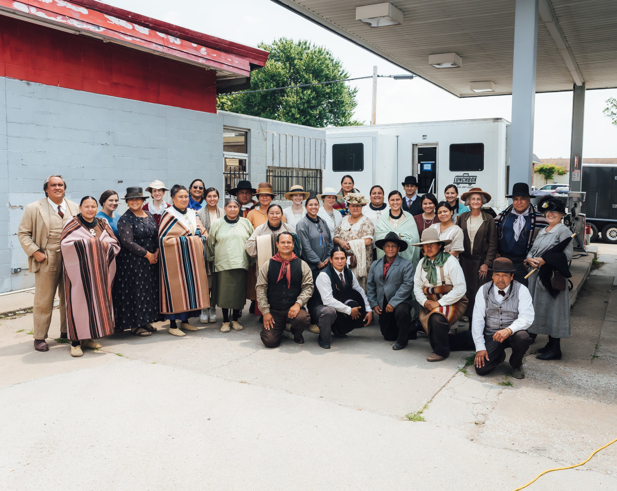 """Filming continues in Fairfax, Oklahoma on the set of the upcoming film, """"Killers of the Flower Moon."""" A group pose for a photo on July 23, 2021. (Photo courtesy of Cody Hammer, Osage News)"""