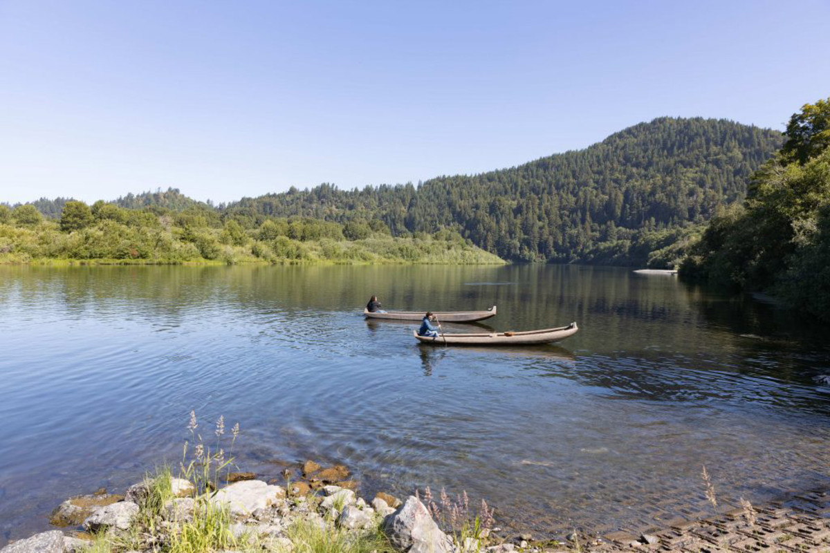 Members of the Ancestral Guard paddle redwood canoes onto the Klamath River, which provides eels, sturgeon and crab in addition to Chinook salmon. Yurok people also gather acorns, berries and other foods that grow on the riverbanks. (Photo by Beth Wallis/News21)