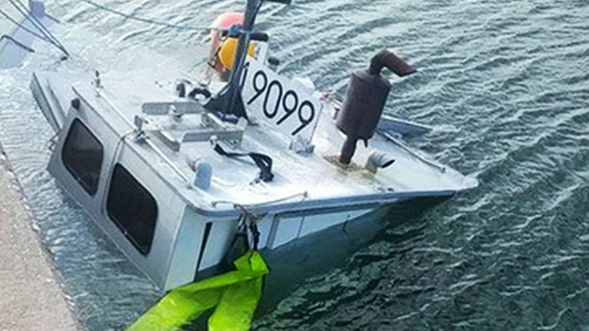 The boat belonging to Ashton Bernard that was sunk after someone drilled holes in the hull. (Photo by APTN)