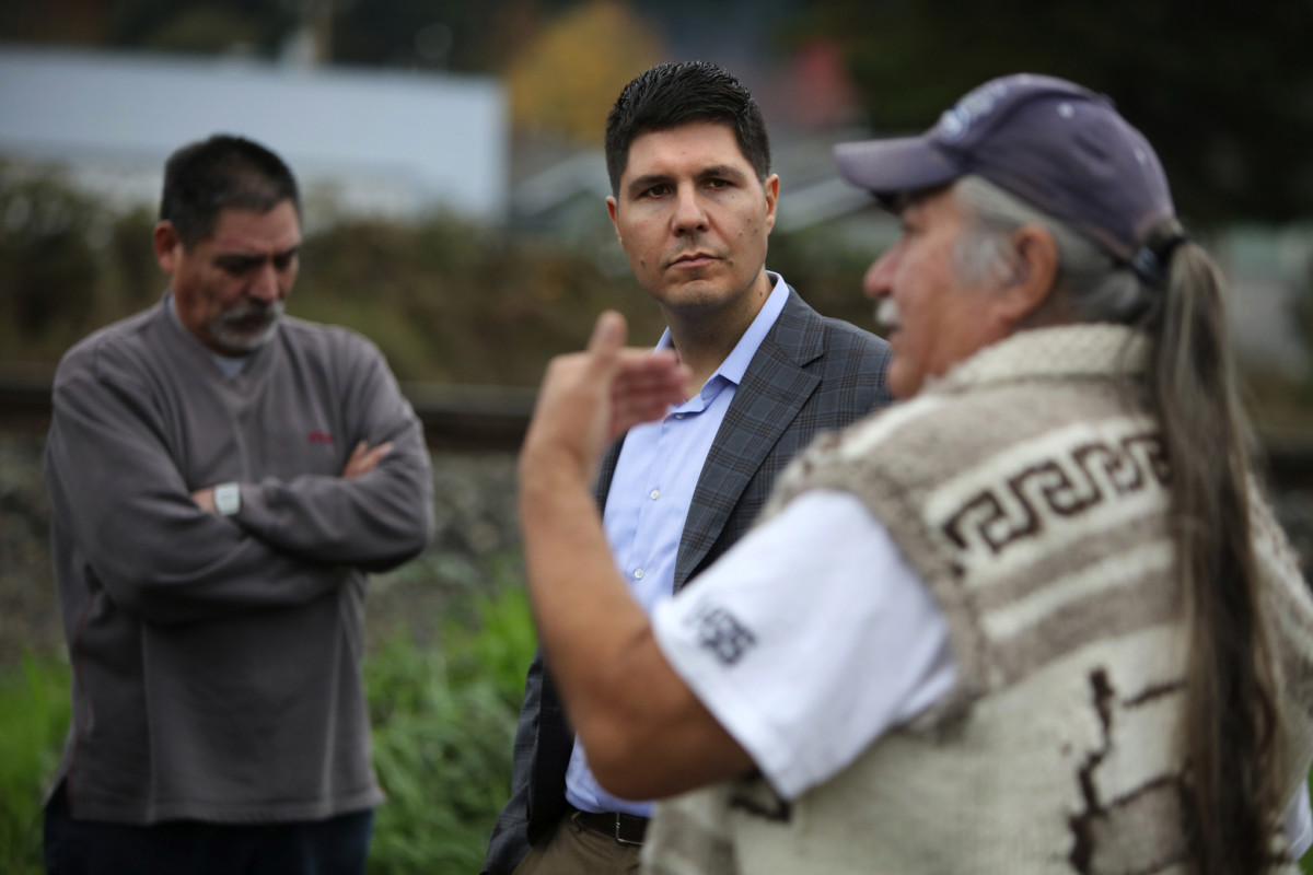 Gabe Galanda, Round Valley Indian Tribes of California, listens to Nooksack members talk about disenrollment.