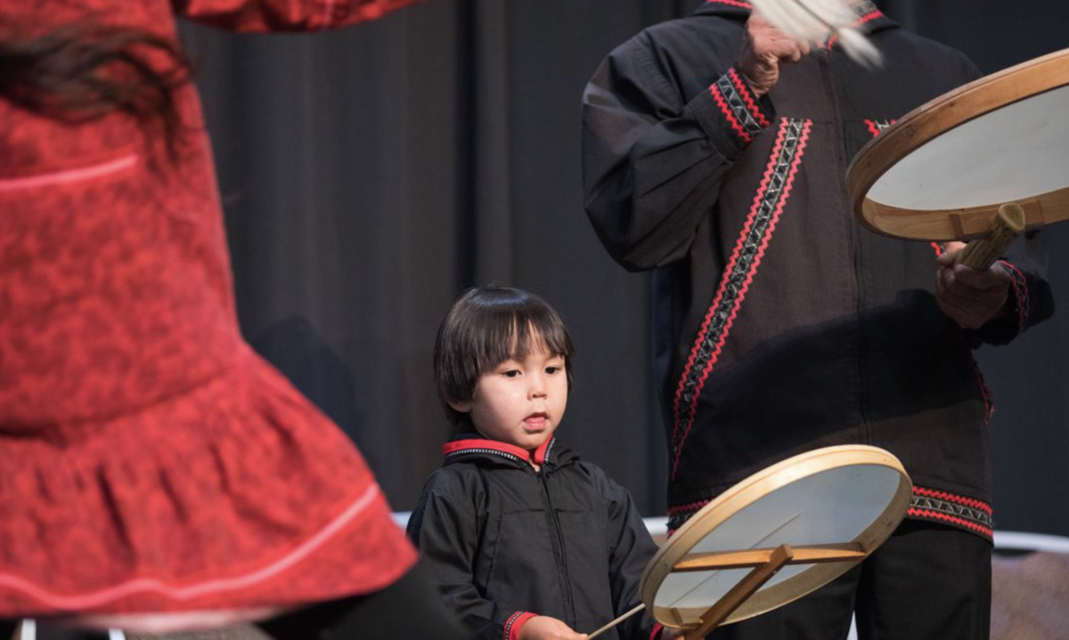 Future generations: a young member of the Acilquq dance group performs with his parents at the annual Elders and Youth conference.