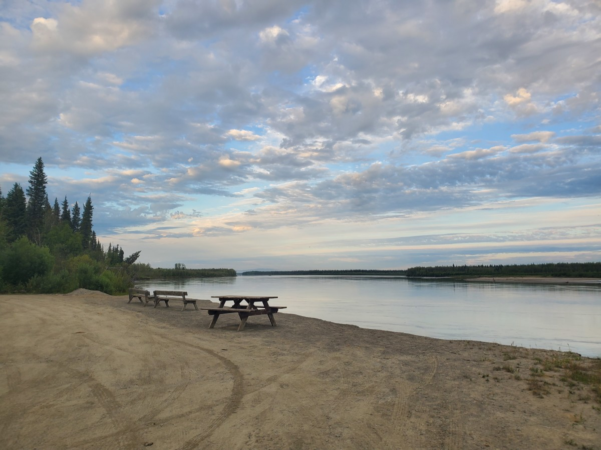 An empty boat launch at Manley Hot Springs on the Tanana River, a tributary of the Yukon River. Usually this time of year the shore would be busy early and late every day with people loading and unloading gear, fish and people, and launching and pulling out boats. 2021 (Photo by Serena Fitka, Yukon River Drainage Fisheries Association)
