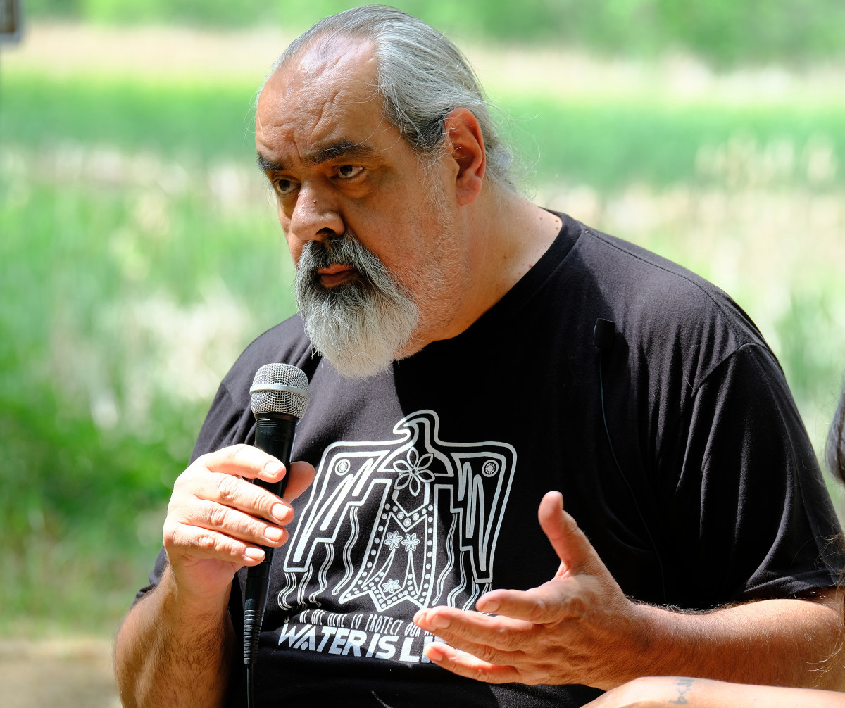 Frank Bibeau, citizen of and attorney for the White Earth Nation discusses his legal strategy at gathering at the Shell City campground in Wadena County, Minnesota, June 2021. (Photo by Mary Annette Pember)