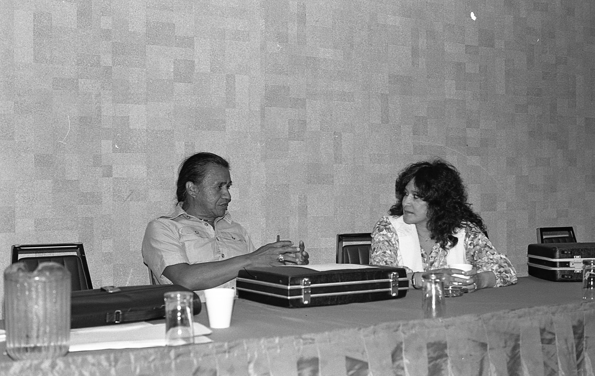 Lorraine Loomis sits with longtime rights and environmental leader Billy Frank Jr. at a meeting of the Northwest Indian Fisheries Commission, which was formed in 1975. Loomis served more than 40 years on the commission and replaced Frank as commission chairperson in 2014. She died Aug. 10, 2021 at age 81. Frank died in 2014. (Photo courtesy of the Northwest Indian Fisheries Commission)