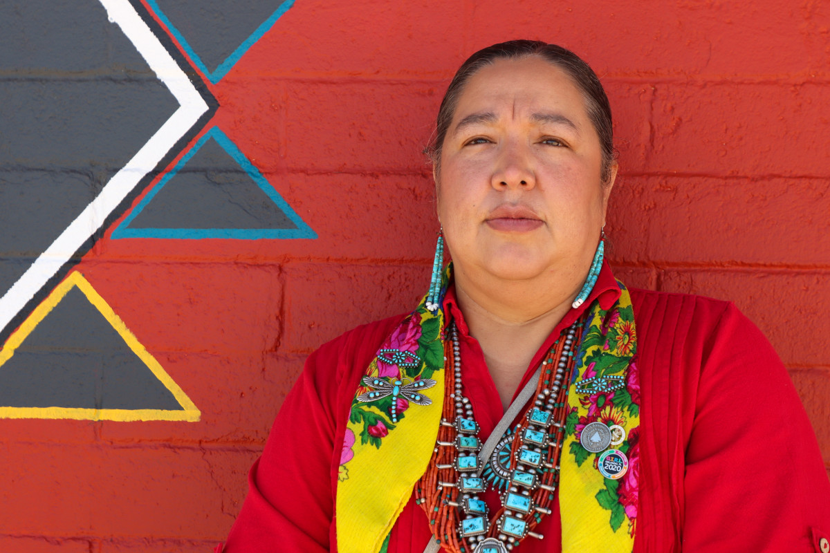 Amber Kanazbah Crotty, delegate to the Navajo Nation Council, stands outside the local chapter house in Sheep Springs, N.M., on July 7, 2021. Crotty, a sexual assault survivor, accompanied Christine Benally to a meeting with the U.S. attorney in New Mexico in 2015 to understand why Benally's son's case was declined. (Brendon Derr / Howard Center for Investigative Journalism)