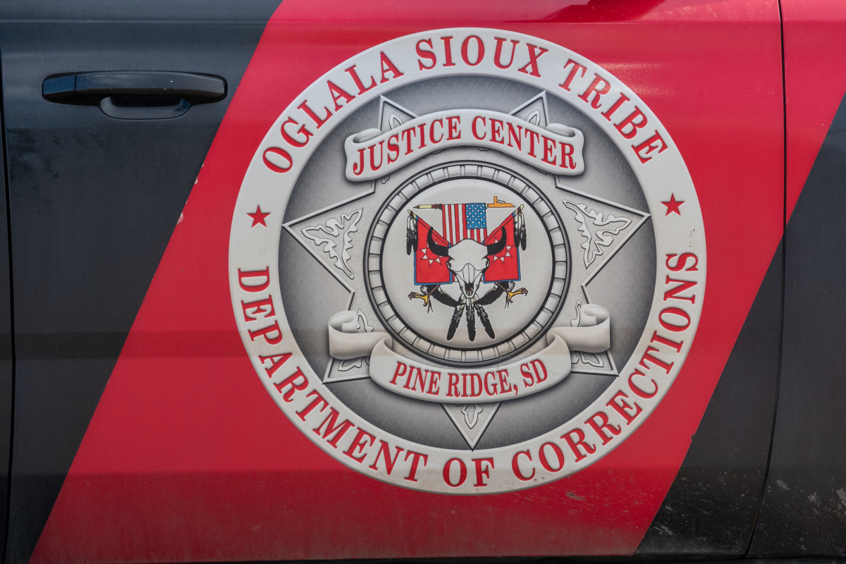 An Oglala Sioux Tribe Department of Corrections vehicle photographed on July 22, 2021. The department is responsible for managing the adult and juvenile correction systems on the Pine Ridge Indian Reservation in South Dakota. (Isaac Stone Simonelli / Howard Center for Investigative Journalism)