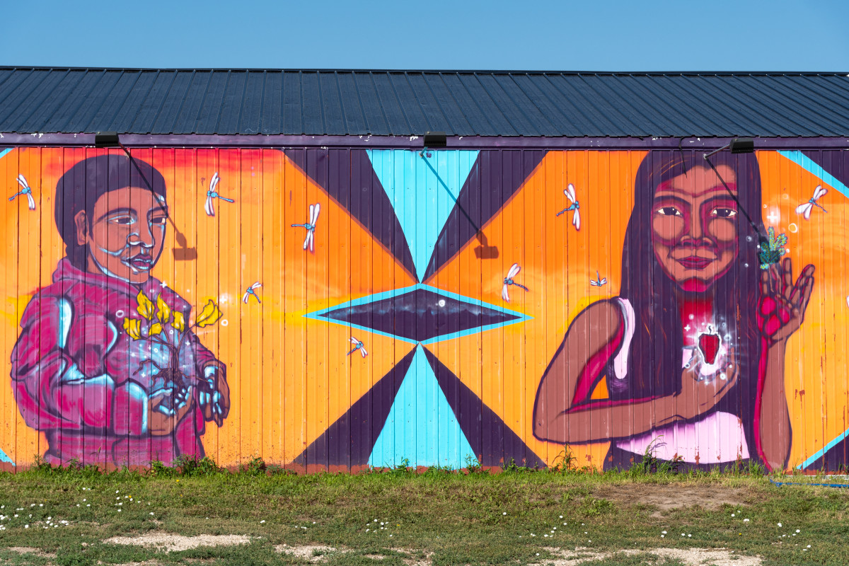 A mural on the Pine Ridge Indian Reservation in South Dakota is visible to traffic along Bigfoot Trail on July 22, 2021. (Isaac Stone Simonelli / Howard Center for Investigative Journalism)