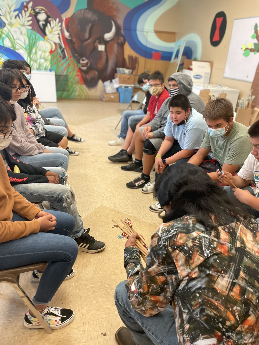Pictured: Dewey Bad Warrior taught Lakota hand games at the culture camp.