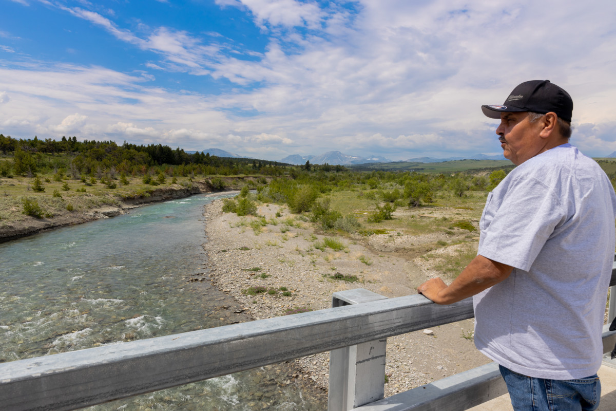 Blackfeet tribal member Richard Horn surveys Badger Creek on the reservation near Browning, Montana. The trauma members of his tribe experienced from the pandemic will leave a lasting impression, he says. (Photo by Beth Wallis/News21)