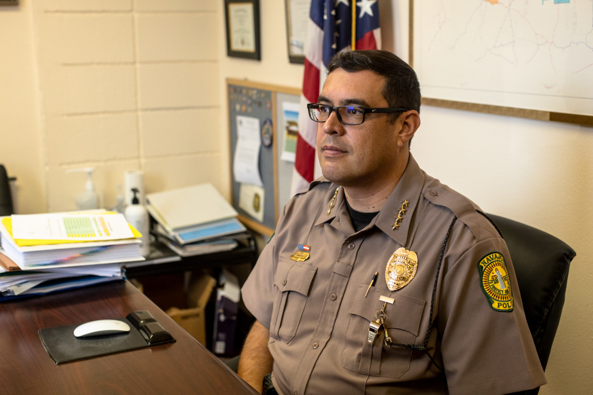 """Navajo Nation Police Chief Phillip Francisco at his desk in Window Rock. He hopes additional federal funding will provide an opportunity for the department's """"renaissance."""" (Photo by Beth Wallis/News21)"""