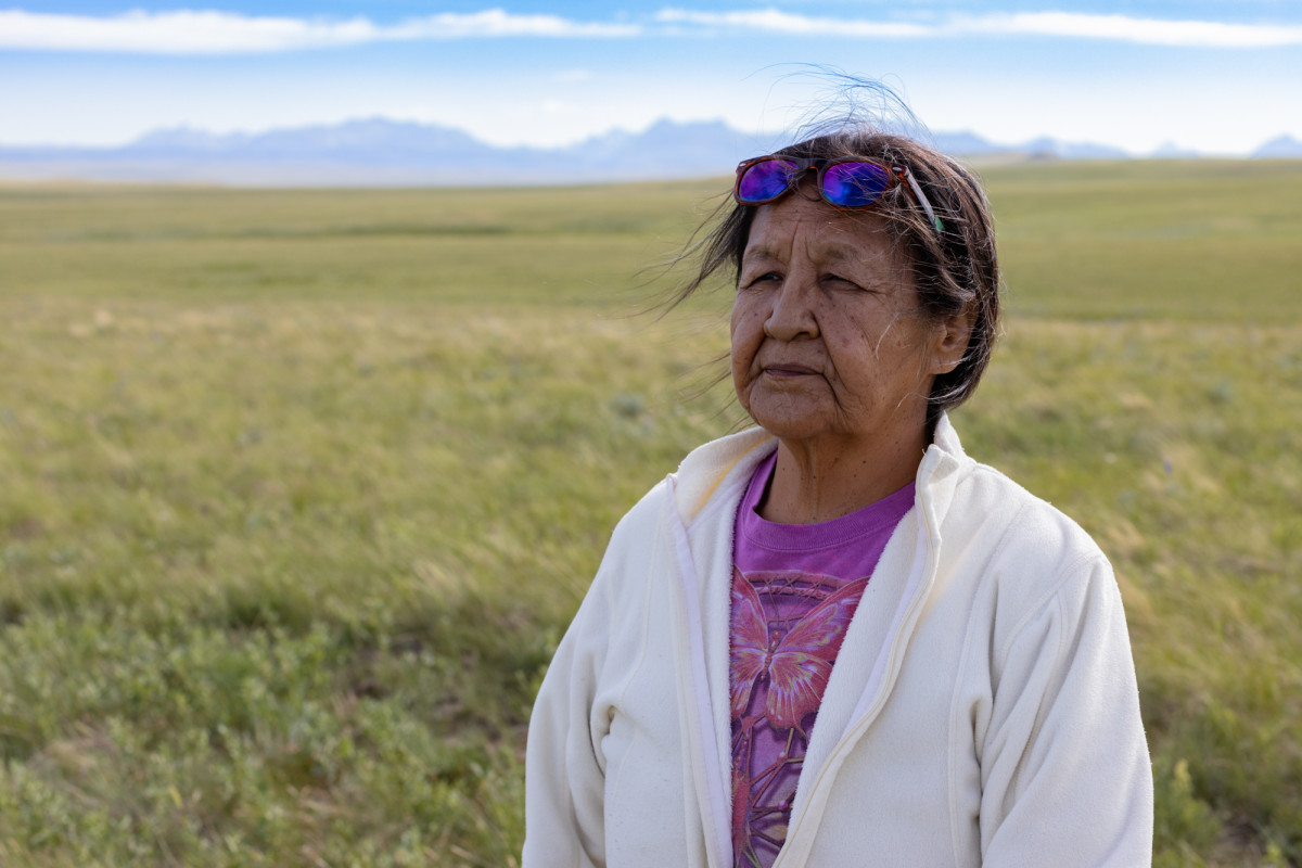 Marietta Green stands on her family's land on the Blackfeet Indian Reservation near Browning, Montana. Green hopes to someday build a house on the remote spot. (Photo by Beth Wallis/News21)