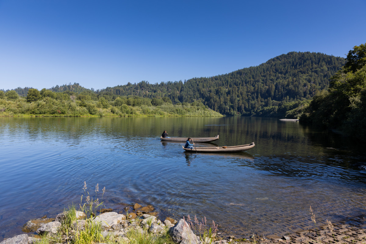 Members of the Ancestral Guard paddle out on traditional redwood canoes in the Klamath River on the Yurok Reservation in Northern California. (Photo by Beth Wallis/News21)