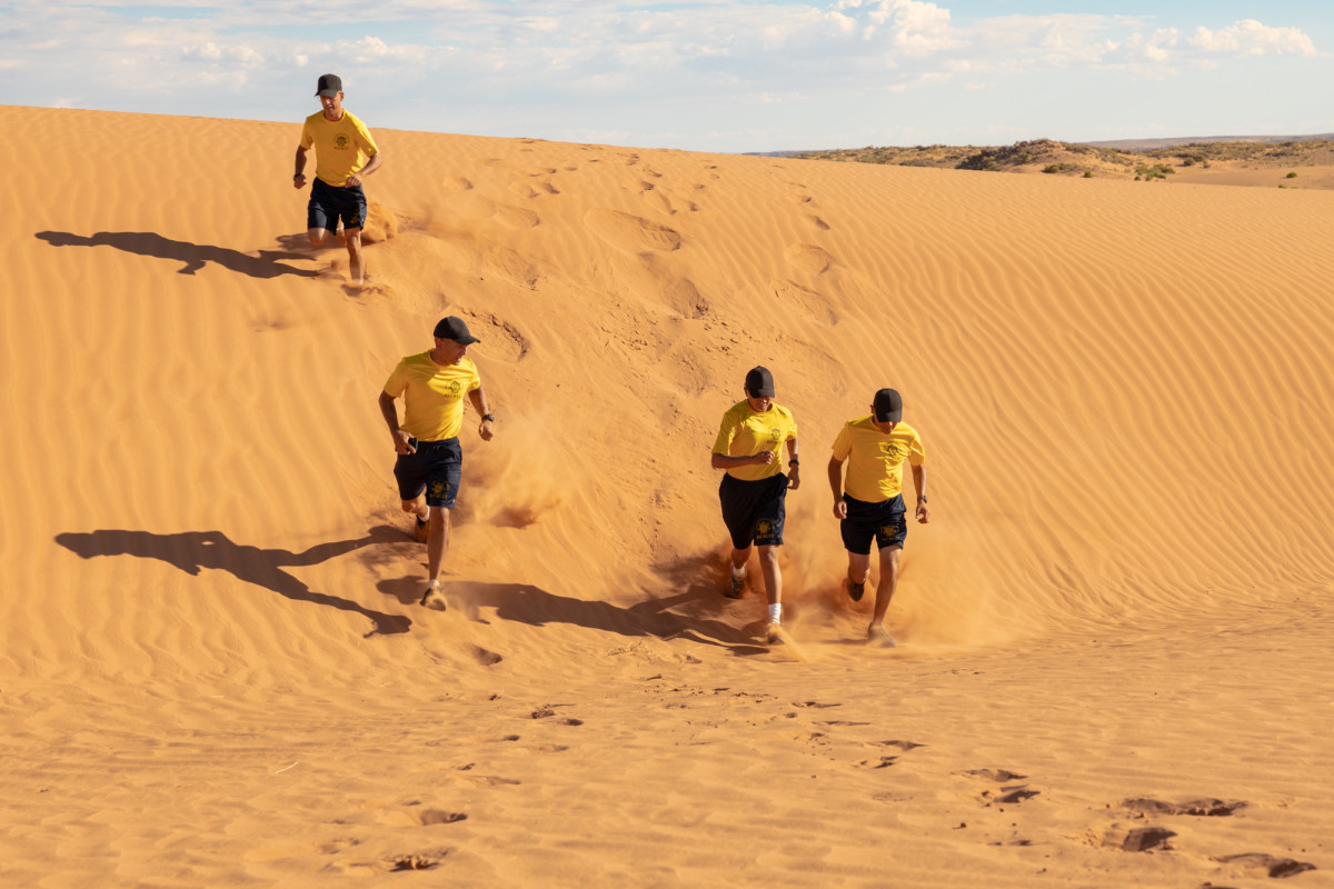 Navajo police recruits run on sand dunes for physical training in Chinle, on the Navajo Nation Reservation. (Photo by Beth Wallis/News21)