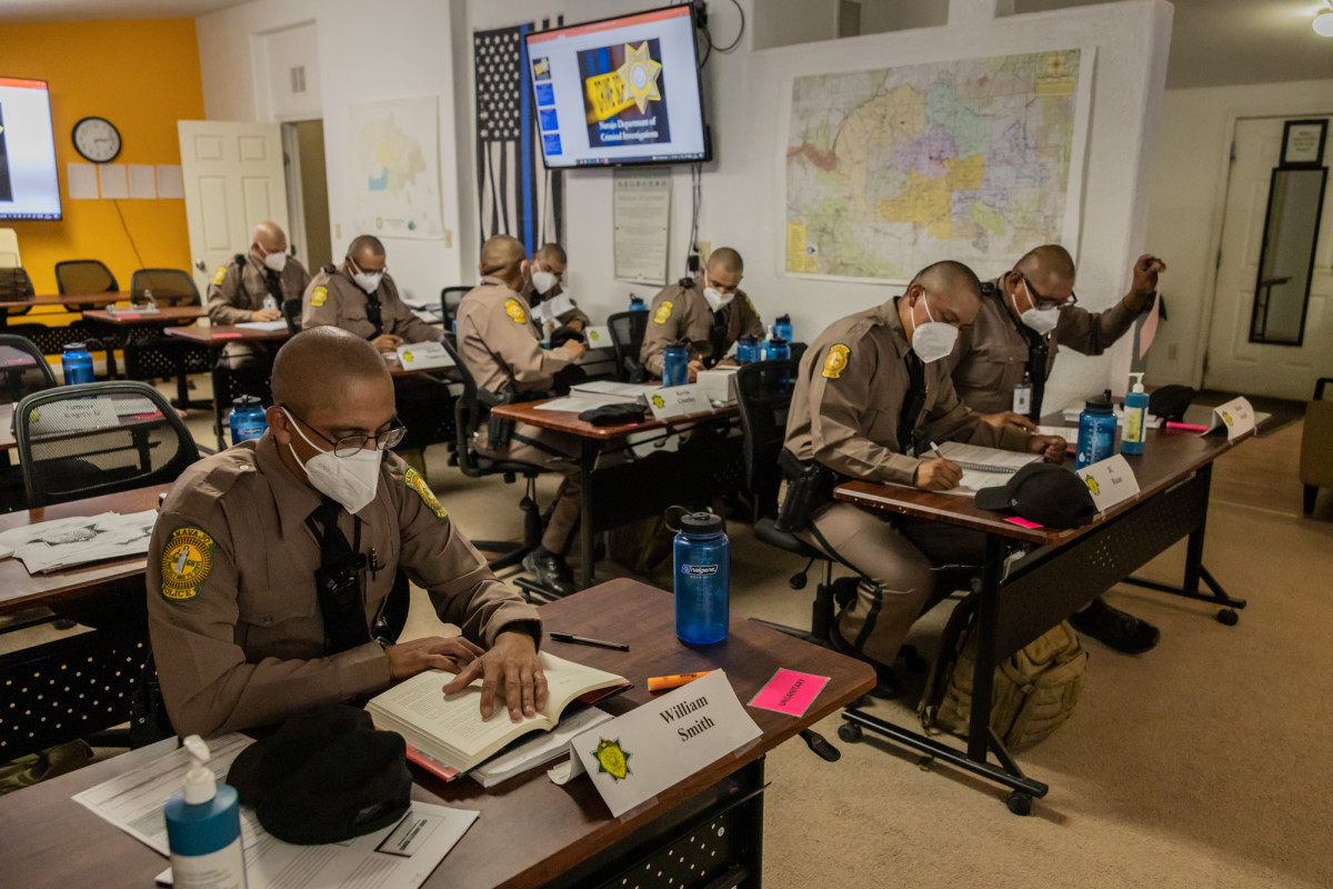 Navajo police recruits study in the department's training academy in Chinle. The academy occupies two double-wide trailers, which limits class sizes. (Beth Wallis/News21)