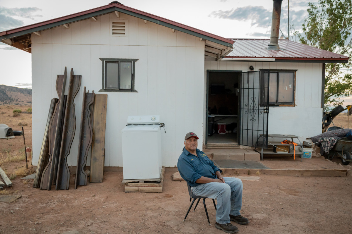 """Roy Slowman sits outside his house in Red Mesa, Arizona, on the Navajo Nation Reservation. """"I've been away 26 years. And right from day one, I wanted to be here,"""" he says. (Photo by Beth Wallis/News21)"""